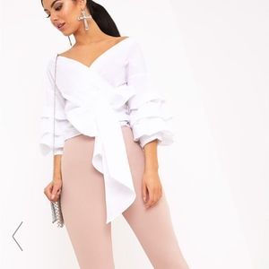70713eb6df6580 PrettyLittleThing Tops - Marlow White Oversized Ruffle Sleeve Low Top